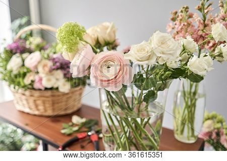 Education In The School Of Floristry. Master Class On Making Bouquets. Summer Bouquet In A Wicker Ba