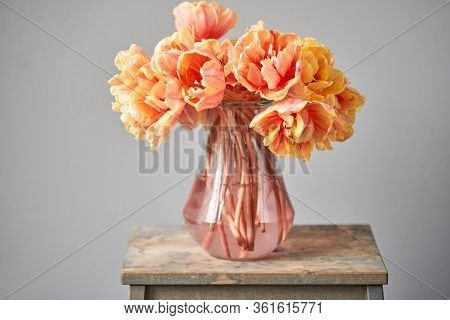 Beautiful Orange And With Red Streaks Tulips In Vase. Flower Background. Floral Wallpaper. Copy Spac