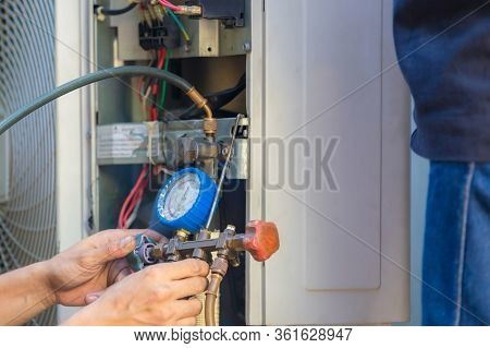 Air Conditioning Repair Man Hands Checking And Fixing Modern Air Conditioning System, Technician Tea