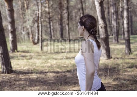 Beautiful Woman In Nature. Happy People Lifestyle. Woman Walking Through Forest Nature. Nature Lifes