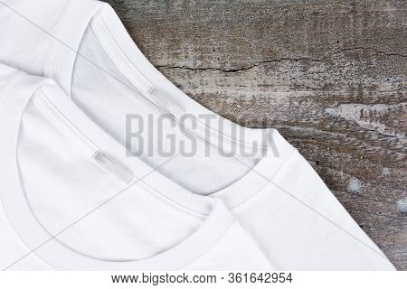 Blank Two White T-shirt For Your Design On Wooden Background.
