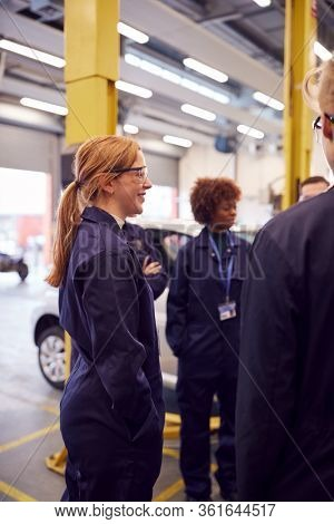 Group Of Students Studying For Auto Mechanic Apprenticeship At College