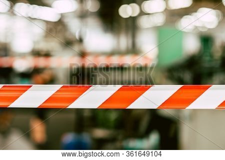 Danger Unsafety Area Caution Do Not Enter Red Stripe Tape With Industry Factory Background.