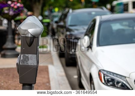A Row Of Parked Cars On The Side Of The Street And A Parking Payment Machine In Princeton, Usa