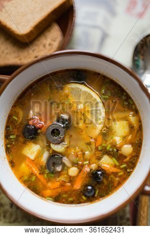Ceramic Plate With Soup Solyanka, Russian Hodgepodge Soup With Olives And Lemon