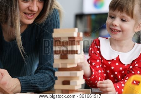 Mom And Daughter Are Sitting At Table Playing Game. Vision Attention Memory And Perception Child. Gi
