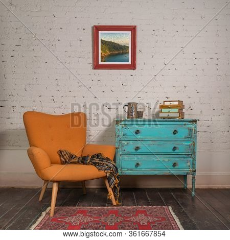 Bright Orange Retro Armchair With Plaid Against White Brick Wall With Shabby Chic Vintage Turquoise
