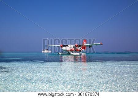 05.19.2019 - Ari Atoll, Maldives: Exotic Scene With Trans Maldivian Airways Seaplane On Maldives Sea