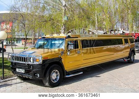 Ufa, Russia - April 22, 2012: Golden Stretch Hummer H2 In The City Street.