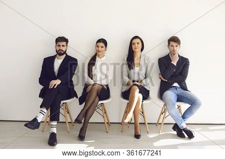 Business People Waiting For Job Interview Recruitment Sitting On A Chair In The Office.