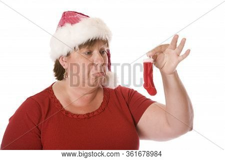 A Woman Disappointed At The Size Of Her Christmas Stocking