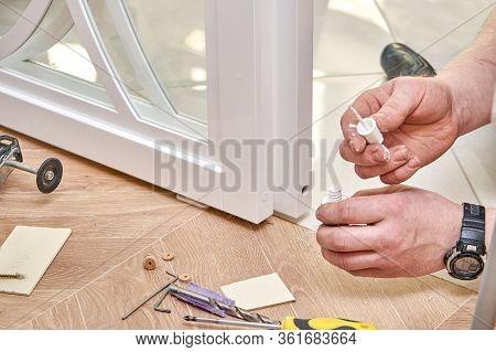 Sliding Glass Doors Repair. Worker Install End Cap. White Sliding Glass Doors With Overlays Decor
