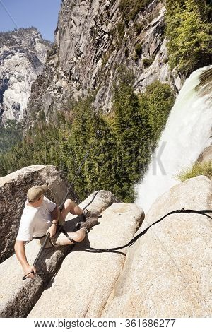 Yosemite National Park, Ca-june 14, 2017: Photographer Taking A Photograph Of The Yosemite Secured W