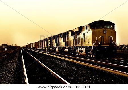 Freight Train Traveling Through Desert