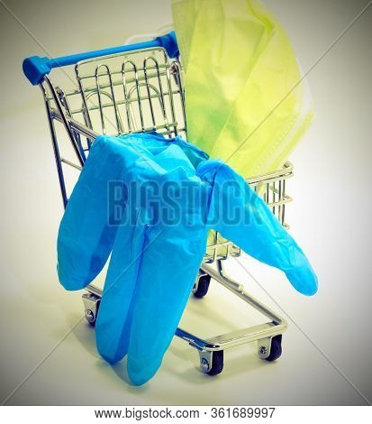 Small Shopping Trolley With Blue Latex Glove And Surgical Mask  With Old Toned Effect
