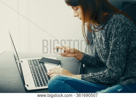 Home Banking. Girl With A Smart Phone With Copy Space At Home, Banner
