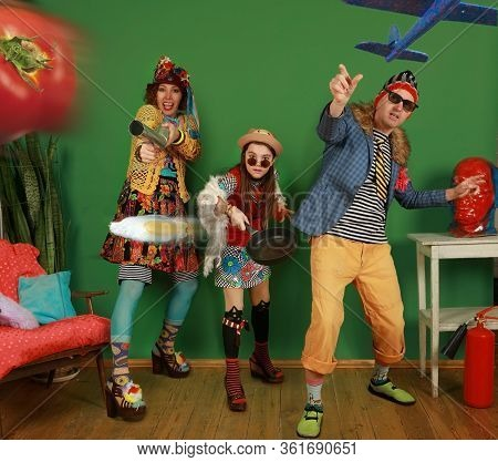 Family Of Freaks Poses And Throws A Tomato, Scrambled Eggs And A Toy Plane At The Camera, Having Fun