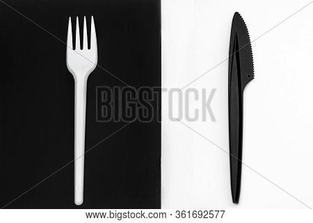 White Fork And Black Knife. Fork On A Black Background, Knife On A White Background.