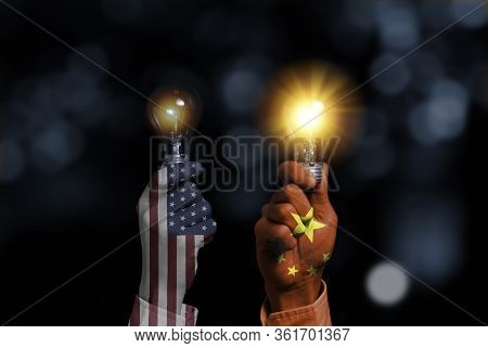 Usa And China Flag Print Screen On Fist Hand Which Holding Lightbulbs Which China 's Lamp Glowing Mo