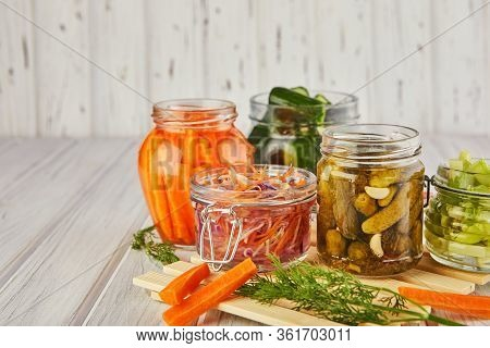 Fermented Preserved Vegetarian Food Concept. Sour Sauerkraut, Pickled Carrots, Pickled Cucumbers, Pi