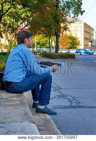 Vienna, Austria - September 2018: Man With An I-pad In The City Center
