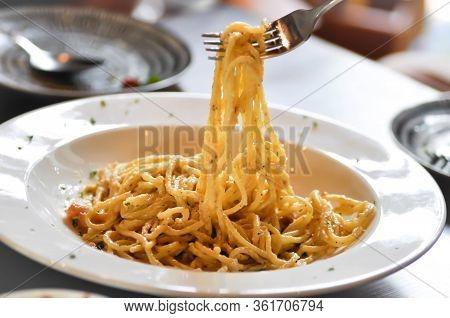 Ladling Pasta Carbonara, Spaghetti Or Spaghetti Carbonara