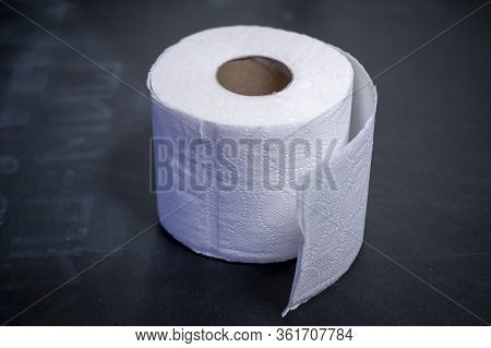 Toilet Paper Roll On The Black Table. Roll Of Toilet Paper On The Table. Toilet Paper Shortages Duri