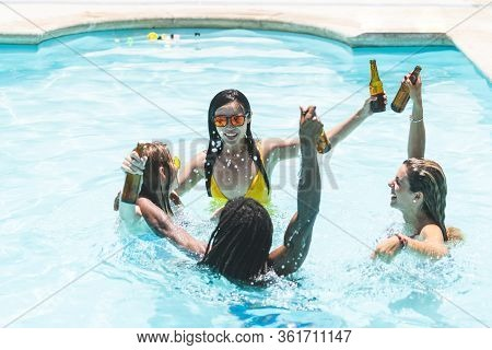 Group Of Friends Having Pool Party And Having Fun.