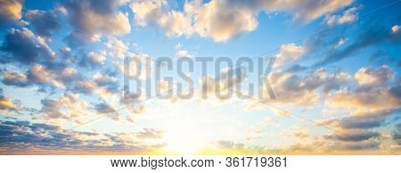 Sky Clouds Background. Beautiful Landscape With Clouds And Orange Sun On Sky