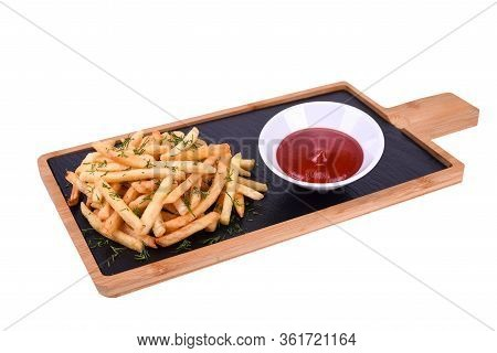 French Fries With Herbs And Ketchup On A Wooden Board Isolated On A White Background.