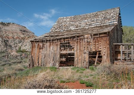 Old Wooden Barn:  A Barn With Missing Shingles And Side Boards Weathers In The Sunshine Of Southern
