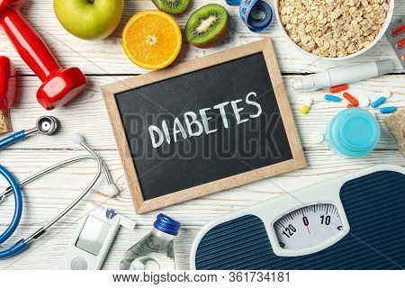 Word Diabetes And Diabetic Accessories On Wooden Background