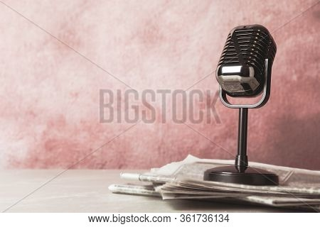 Newspapers And Vintage Microphone On Table, Space For Design. Journalist's Work