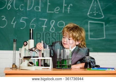 Chemistry Lab. Back To School. Little Kid Learning Chemistry In School Laboratory. Kid In Lab Coat L