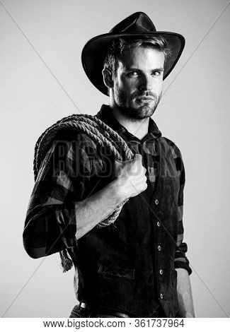 Real Man. Vintage Style Man. Wild West Retro Cowboy. Cowboy With Lasso Rope. Western. Wild West Rode