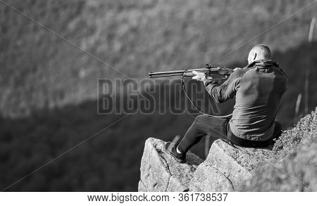 Hunter Hold Rifle. Hunter Spend Leisure Hunting. Man Brutal Gamekeeper Nature Landscape Background.