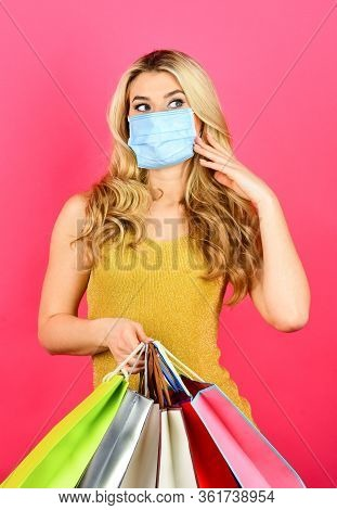 Safe And Healthy Shopping. Woman In Respirator Mask With Paper Bags. Shopper Protect Herself From Co