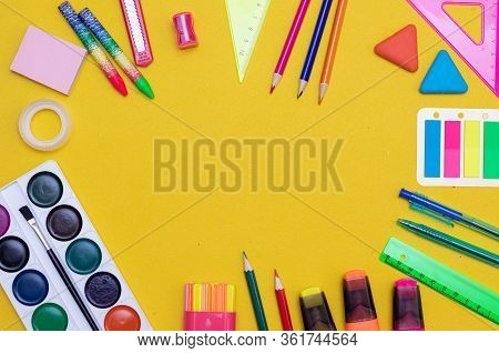 Office Supplies On A Yellow Background. Various School Supplies On A Bright Yellow Background. Text