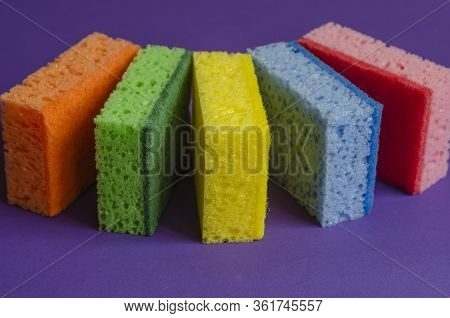 Kitchen Sponges On A Lilac Background.