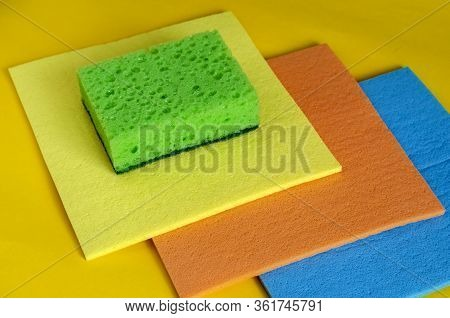 Kitchen Napkins For Cleaning And A Sponge On A Yellow Background.