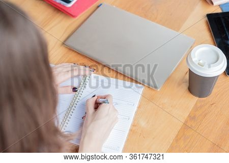 Business Woman Records Event,makes Appointment By Pen In Organizer At Home Office,drinking Coffee.wo