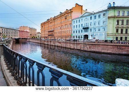 Moika River And Neberezhnaya Griboyedov Canal Embarkment View Towards Kokushkin Most Bridge In Saint