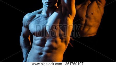 Two Shirtless Hunks At Black Background. Close Up Of An Athletic Guy With Perfect Abs. Hunky Shirtle