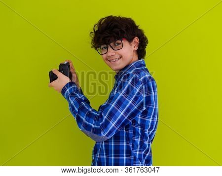 enthusuast arab teen photographer with analog slr camera on pink packground
