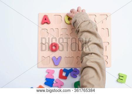 Bird Eye View Of Preschooler, Kindergarten Boy Playing With Alphabet Blocks, Children Learning Engli