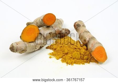Turmeric Powder And Turmeric Root Extract Isolated On A White Background Are Used As A Tonic For The