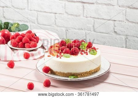 Cheesecake With Fresh Raspberries And Plums
