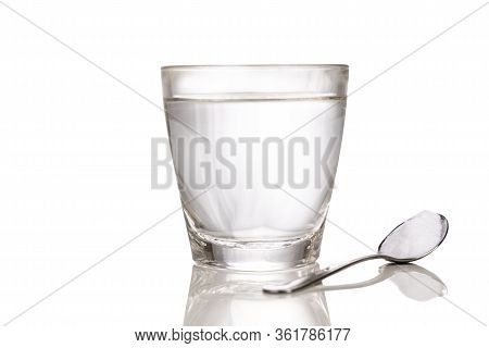Ors Or Oral Rehydration Salt With Glass Of Water And Spoon With White Background