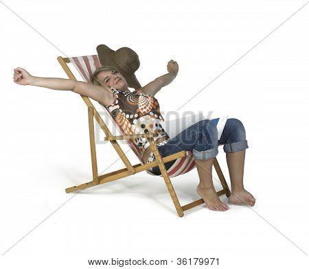 Cute Girl Sprawling In A Canvas Chair