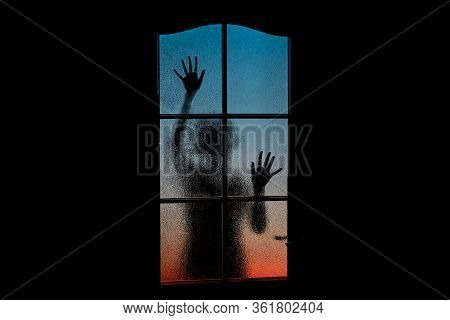 Dark Silhouette Of Girl Alone In Isolation On Light Background Behind Closed Glass Door. Abstract Im